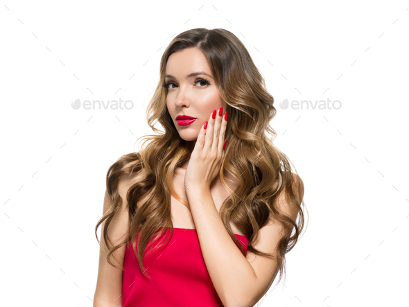 Beautiful woman with red manicured nails and red lipstick long curly hairstyle female portrait - Stock Photo - Images