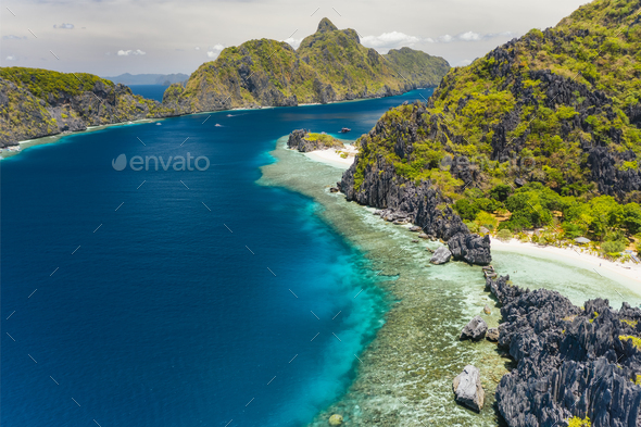 Matinloc Island aerial view coast line blue sea and lime stone cliffs - Stock Photo - Images