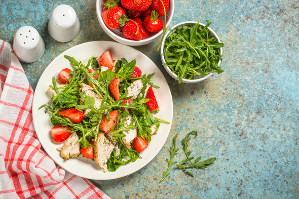 Green salad with chicken, strawberry and arugula - Stock Photo - Images