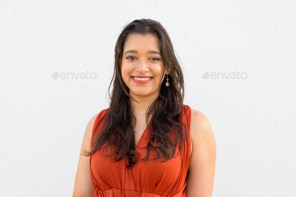 Face of happy young beautiful Indian woman smiling against white background - Stock Photo - Images