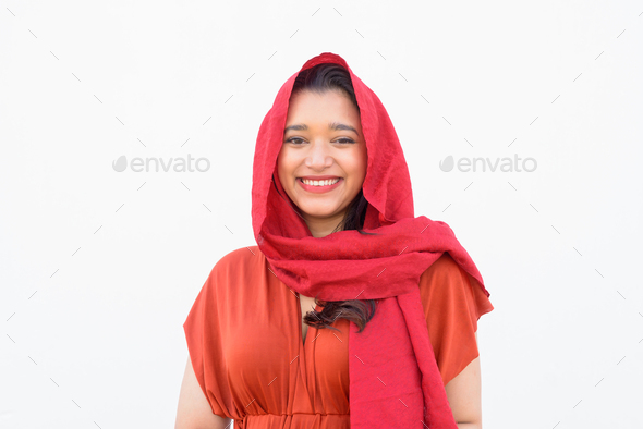 Face of happy young beautiful Indian woman with headscarf smiling against white background - Stock Photo - Images