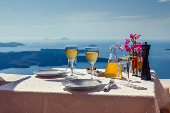 Table and two glasses of wine  the island of Santorin - Stock Photo - Images