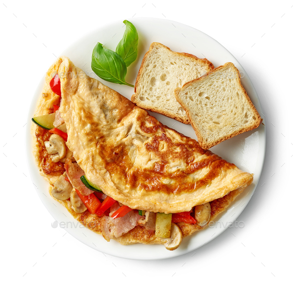 omelette stuffed with vegetables and ham - Stock Photo - Images