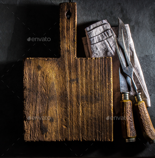 Cooking background. Vintage cutting board and cutlery - Stock Photo - Images