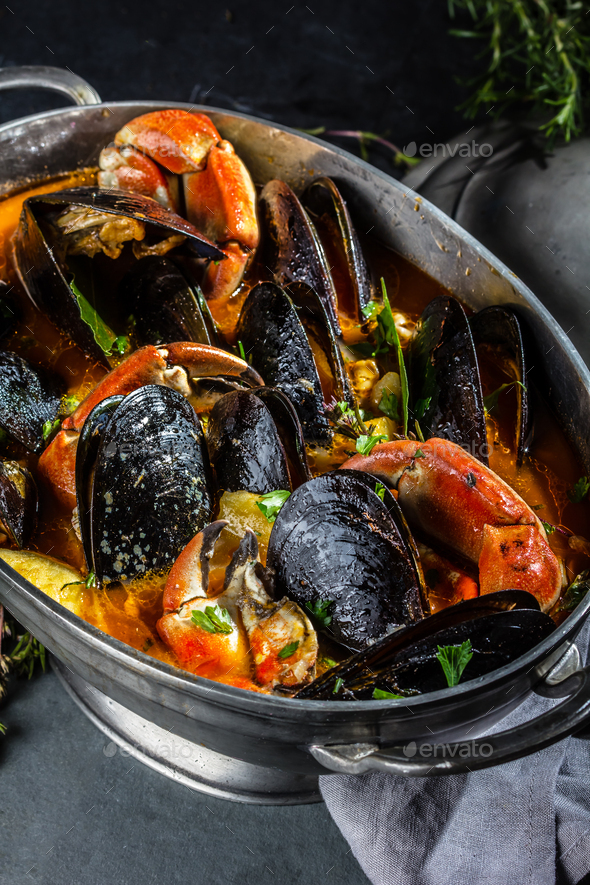 Seafood mussels crabs soup in metal pot - Stock Photo - Images