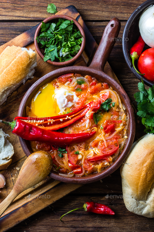 Chilean food. Picante caliente. Tomatoes, onion, chili fried with eggs - Stock Photo - Images