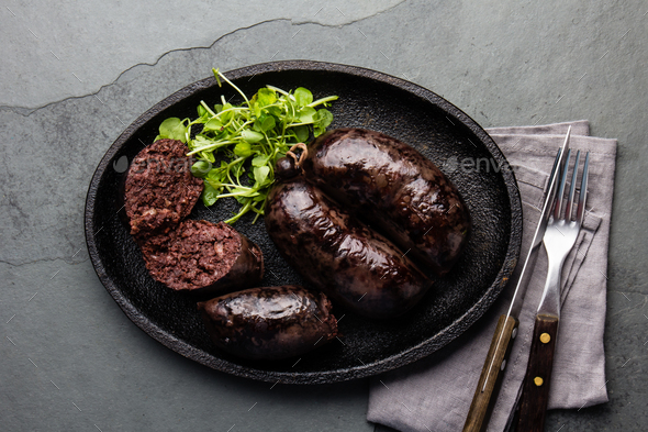 Bloody sausages - chilean preta on iron plate, top view, grey slate background - Stock Photo - Images
