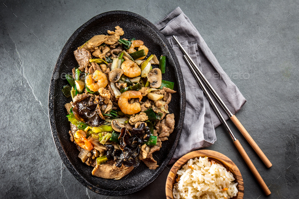 Chinese food. Te pam sao. Pan of fried different meat, shrimps shiitake mushroom - Stock Photo - Images