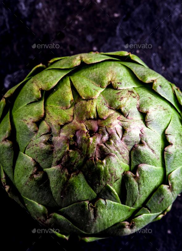 ARTICHOKE. Close up of artichoke, top view, dark background. Macro - Stock Photo - Images