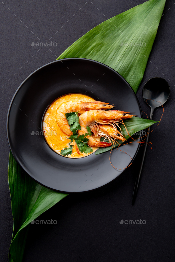 Seafood Soup Decorated With Whole Shrimps And Tropical Leaves On Black Plate Black Background Stock Photo By Lblinova Tropical background nature beach summer water green paradise jungle sea. https photodune net item seafood soup decorated with whole shrimps and tropical leaves on black plate black background 27085234