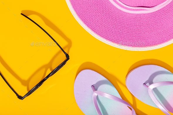 Flat lay composition with summer vacation accessories on yellow background - Stock Photo - Images