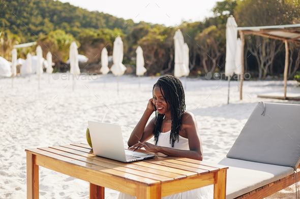 Freelancer working on beach - Stock Photo - Images