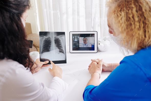 Physician video calling experienced pulmologist - Stock Photo - Images