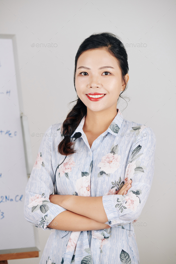 Smiling science teacher - Stock Photo - Images