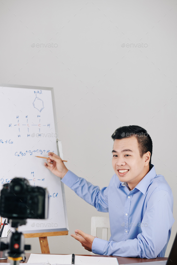 Man conducting chemistry class - Stock Photo - Images
