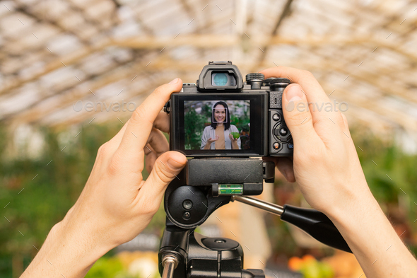 Adjusting camera for shooting video review - Stock Photo - Images