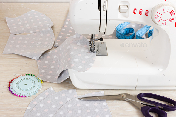 Sewing reusable fabric masks at home for coronavirus protection. - Stock Photo - Images