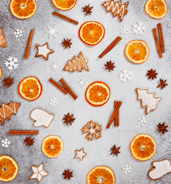 Christmas ginger cookies, dried orange, cinnamon,  and star anise on gray stone background. - Stock Photo - Images