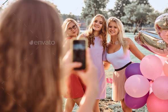 Group of happy friends having fun together celebrating a birthday at the outdoor park. - Stock Photo - Images