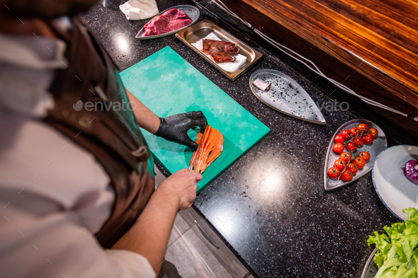 Cutting fish for dish - Stock Photo - Images