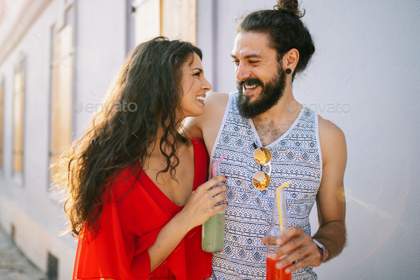 Happy couple, friends having fun together and drinking in the city - Stock Photo - Images