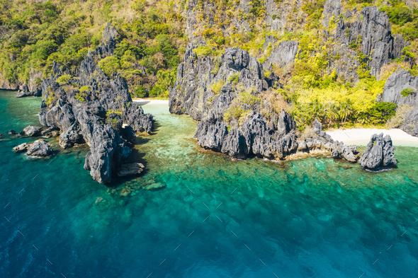 El Nido, Palawan Island. Hidden lagoon coastline. Limestone rock formations on famous tropical beach - Stock Photo - Images
