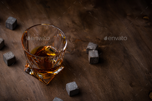Glass of whiskey and stones - Stock Photo - Images