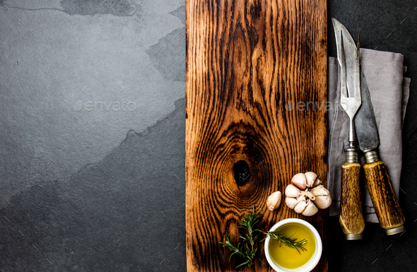 Cooking background concept. Vintage cutting board with cutlery. Top view - Stock Photo - Images