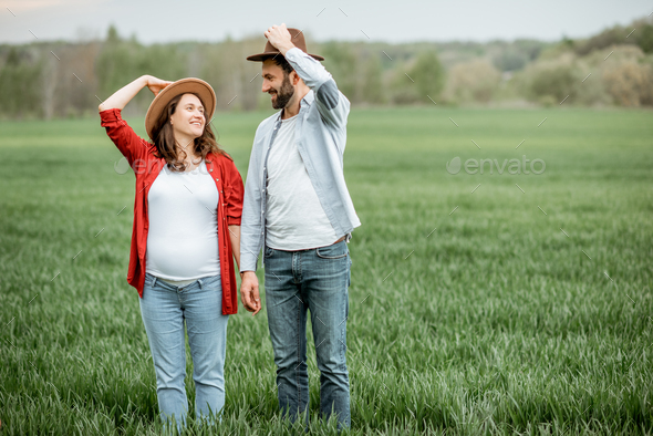 Lovely couple on the greenfield - Stock Photo - Images