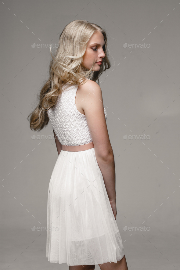 Beautiful female portrait in white dress - Stock Photo - Images