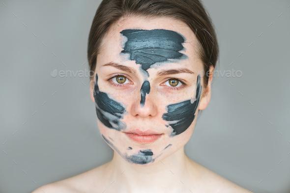 Woman clay face mask peeling natural - Stock Photo - Images