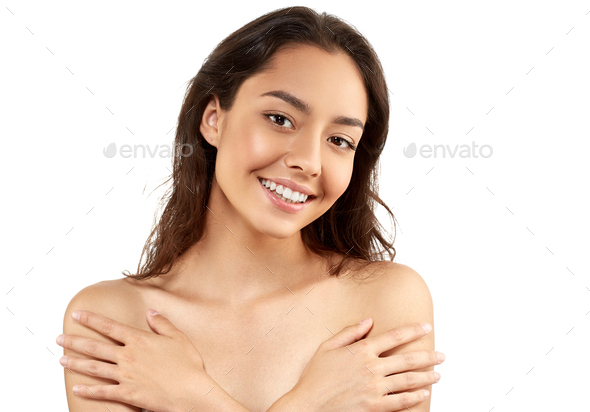 Brunette female looking at camera and smiling. Youth and Skin Care Concept - Stock Photo - Images
