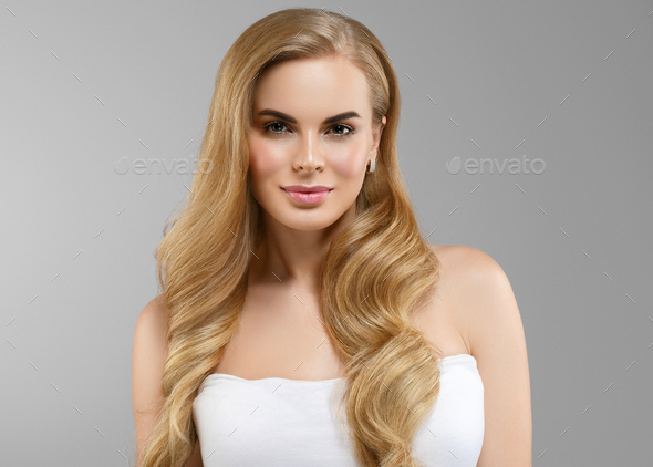Long hairstyle woman blonde curly hair natural beauty - Stock Photo - Images