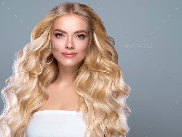 Long curly fly hair woman portrait - Stock Photo - Images