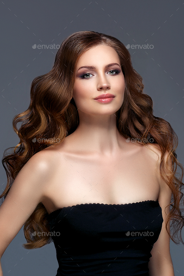 Brunette female looking  camera smiling  blue background Beautiful hairstyle Youth Skin Care Concept - Stock Photo - Images