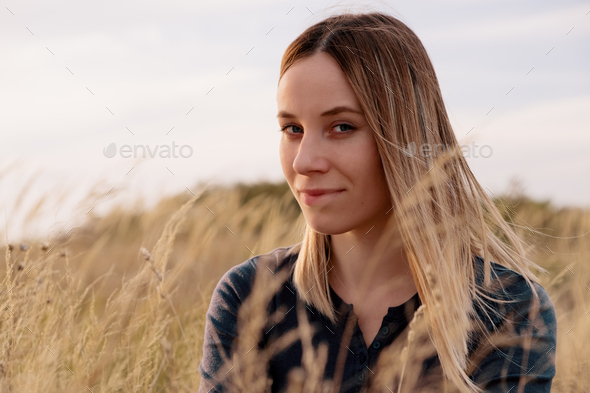 Portrait lovely young woman relaxing in the field - Stock Photo - Images