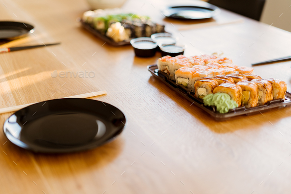 Waiting for friends with sushi rolls - Stock Photo - Images