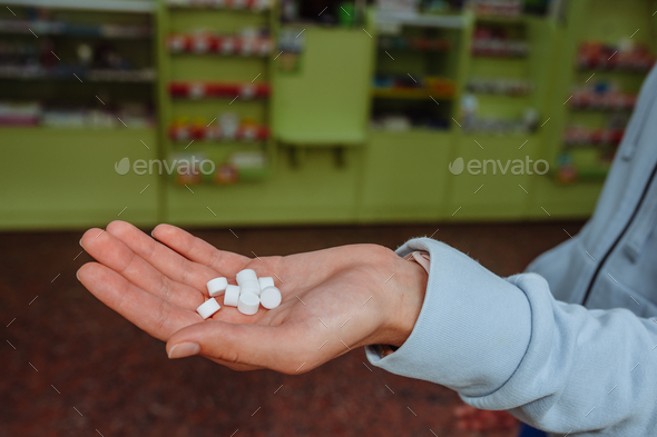 Coronavirus. Covid-19. A man or woman takes and shows pills - Stock Photo - Images