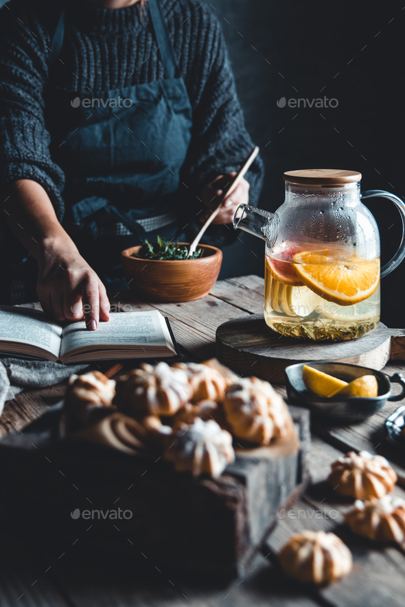 Woman cooks in a vintage kitchen on wooden tablet. Healthy drink, Eco, vegan - Stock Photo - Images
