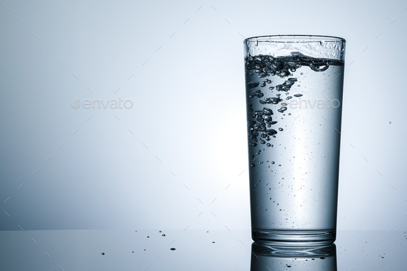 Tall tumbler filled with sparkling water - Stock Photo - Images