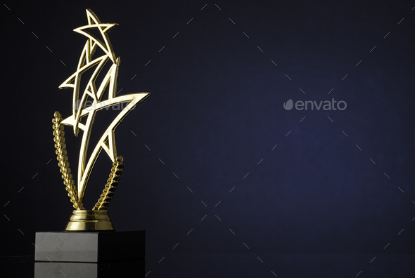 Stylish trophy with three gold stars and wreath - Stock Photo - Images