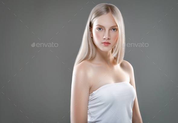 Beautiful Woman Face Portrait Beauty Skin Care Concept with long blonde hair  over gray background - Stock Photo - Images