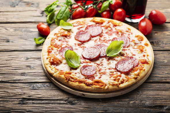 Italian pizza with tomato and salami - Stock Photo - Images