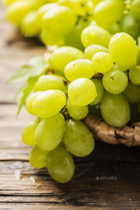 Sweet yellow grape with leaves - Stock Photo - Images