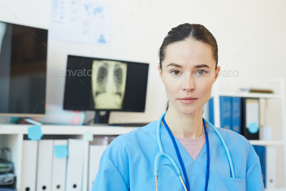 Portrait of Young Female Medic in Clinic - Stock Photo - Images