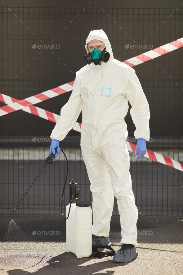 Disinfection Worker with Danger Tape - Stock Photo - Images
