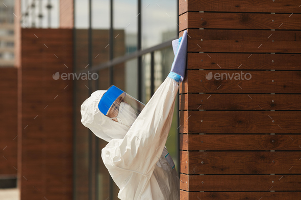 Female Worker Disinfecting Building - Stock Photo - Images