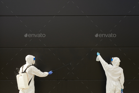 Worker Disinfecting Black Wall Background - Stock Photo - Images