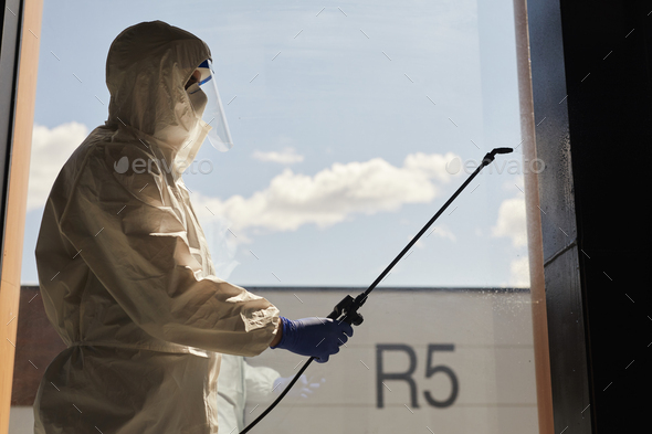 Backlit Portrait of Disinfection Worker - Stock Photo - Images