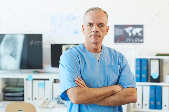 Portrait of Mature Male Medic in Clinic - Stock Photo - Images
